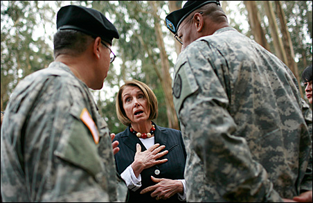 U.S. House Speaker Nancy Pelosi, speaking with U.S. Army command Sgt. Maj. Roy Wells (right) and Brig. Gen. James Cook in San Francisco last month, says she opposes a surtax to pay for the war in Afghanistan.
