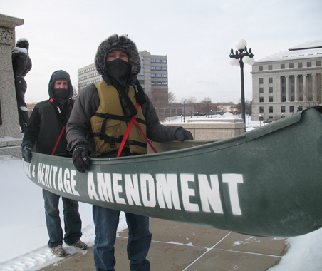 Nick Boerum (back) and Tony Stoering of the Minnesota Environmental Partnership brave the cold at the Capitol.