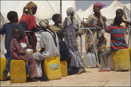 Families line up for water provided by Minnesota donors.