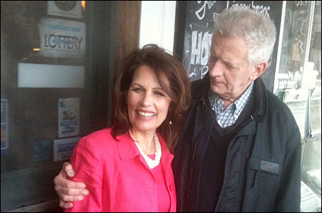Michele Bachmann poses with Joel Sherburne, who has worked at Calef's Country Store, the iconic Barrington shop, for 53 years.