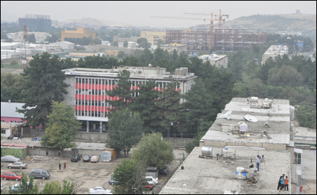 The view from the eighth floor of the unfinished high-rise from which insurgents attacked the nearby U.S. Embassy in Kabul in mid-September. The embassy compound lies to the left of the cranes seen in the background.