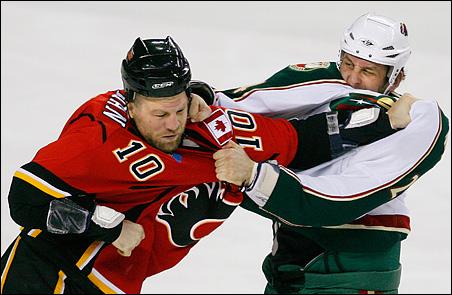 Minnesota Wild forward Derek Boogaard, right, punching Calgary Flames forward Brian McGrattan in their fight during a December 2009 game.