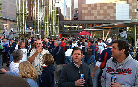 Fans converge on Target Field for Wednesday's opening playoff game against the Yankees.