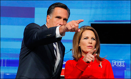 Mitt Romney and Michele Bachmann looking into the crowd prior to the debate.