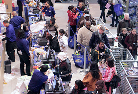 """People shopping in the Times Square Toys 'R' Us store on """"Black Friday"""" 2008."""