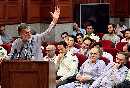 A member of a moderate political party, Mohammad Atrianfar, left, dressed in prison garb, speaks at a tribunal session in Tehran on Aug. 1.