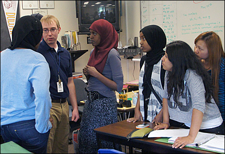 Anthony Padrnos, second from left, chats with students from his precalculus class.