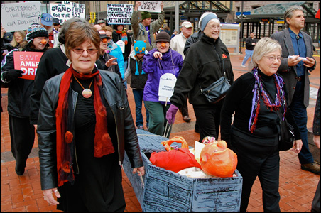 """Protesters participate in a """"New Orleans-style wake for the middle class."""""""