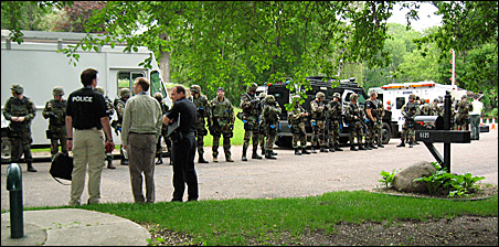 SWAT teams from five suburban police departments gather on a quiet street in Edina's Indian Hills neighborhood for a full day of training.
