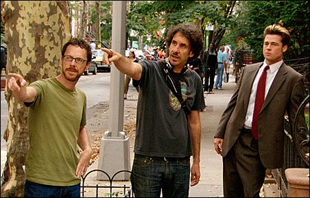 """Ethan Coen, Joel Coen and Brad Pitt on the set of """"Burn After Reading."""""""