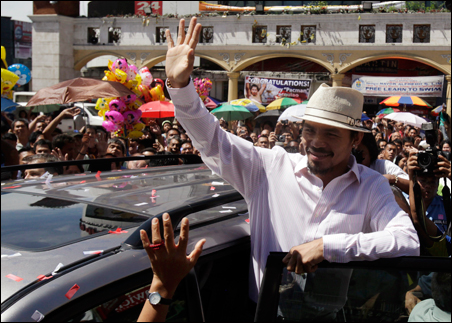 Filipino boxer Manny Pacquiao waves to his fans as he arrives to attend mass at a church in Quiapo, Manila.