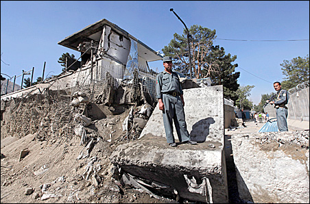 Afghan policemen keep watch at the site of a blast outside the Indian embassy in Kabul, Afghanistan, Thursday, Oct. 8, 2009.