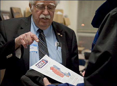 """Precinct co-chair Dick Mueller shows a map depicting the """"blueing"""" of the eastern part of Senate District 33."""