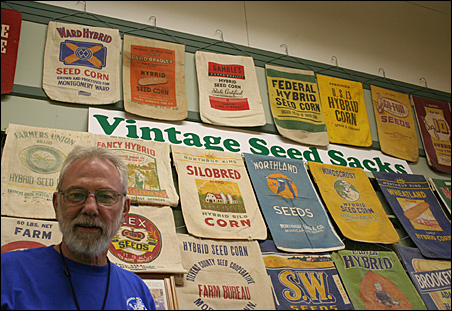 Ron Kelsey shows off his cloth seed sack collection at the Minnesota State Fair.