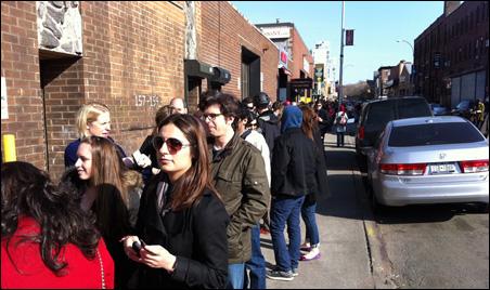 "A long line of Minnesota expats wait to enter the ""Minnesota State Fair Affair."""