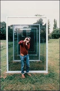 "Dan Graham photographing ""Two Adjacent Pavilions."""