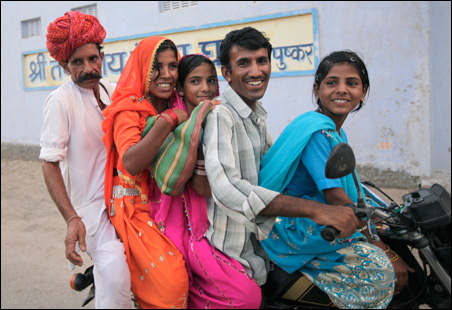 A family rides a motorcycle in Pushkar, Rajasthan, June 24, 2009.