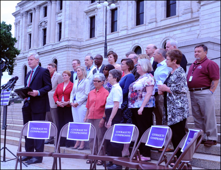 Six folding chairs branded with signs were arrayed on the Capitol steps as a symbol of the GOP votes that would be needed to join House DFLers in passing Dayton's tax increases.