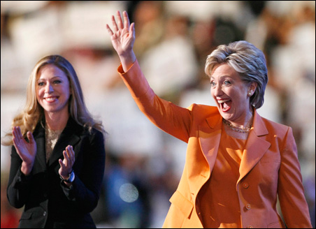 Sen. Hillary Rodham Clinton enthusiastically greets the crowd Tuesday in Denver after daughter Chelsea Clinton introduces her.