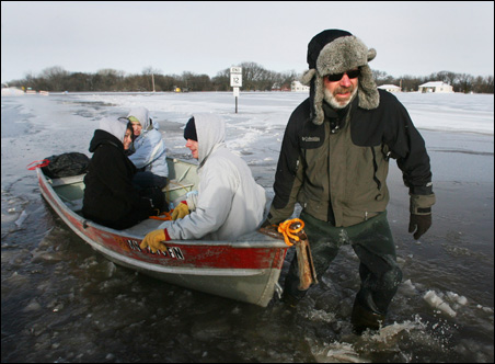 Farrell Turner, right, towed Amanda Monson, left, Ashley Jones and his son, Cody, to safety in Moorhead last Friday.