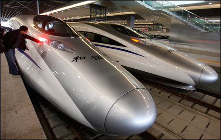 A man looks at the bullet trains serving the new high-speed railway linking Shanghai and Hangzhou in China.