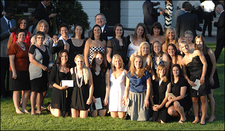The University of Minnesota-Duluth women's hockey team poses on the south lawn of the White House.