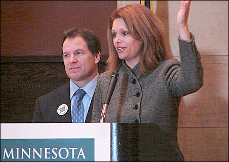 Rep. Paul Marquart, DFL-Dilworth, and Sen. Tarryl Clark, DFL-St. Cloud, face a barrage of questions at a Minnesota Council of Nonprofits rally Thursday.