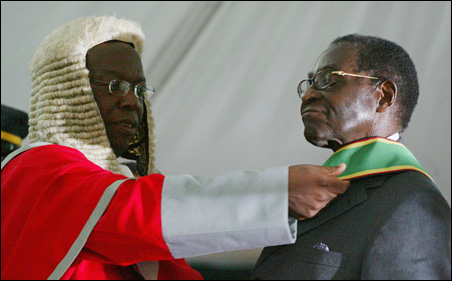 President Mugabe is sworn in during his inauguration Sunday in Harare.