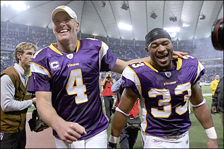 Quarterback Brett Favre and safety Jamarca Sanford smile as they leave the field on Sunday.