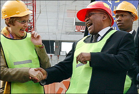 South African President Jacob Zuma laughs with opposition Democratic Alliance leader Helen Zille during a visit to Green Point stadium in Cape Town, June 11, 2009.