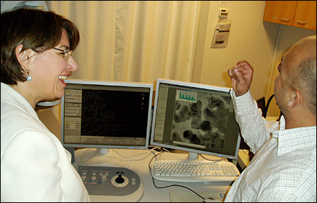 A U of M researcher, right, explains nano-scale technology to Sen. Amy Klobuchar during a tour of the Nanofabrication Center last week.