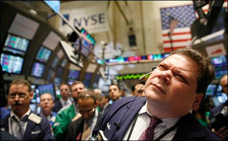 Traders work the floor of the volatile New York Stock Exchange.