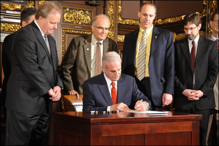 At a bipartisan ceremony, Gov. Mark Dayton signs the agriculture bill.