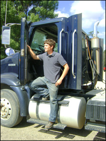Dan Roberts steps out of one of the two tractor-trailers his family uses to operate their 2,000-acre farm.