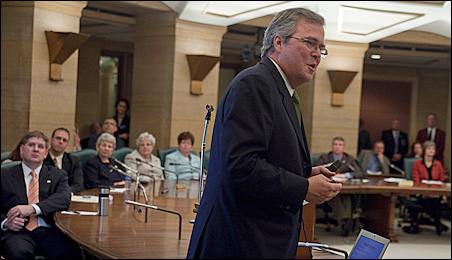 Jeb Bush discussing Florida education reforms with Minnesota lawmakers earlier this week.