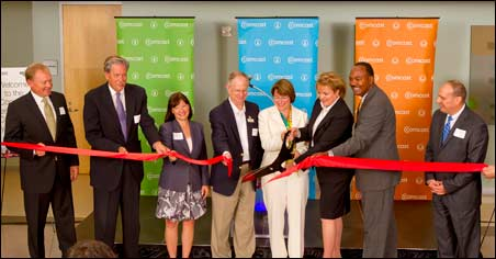Comcast executives and local and state government officials celebrated the opening of a new Comcast call center in Minnetonka.
