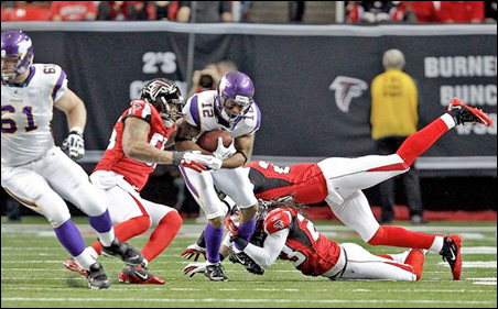Percy Harvin being tackled during Sunday's game versus the Falcons.