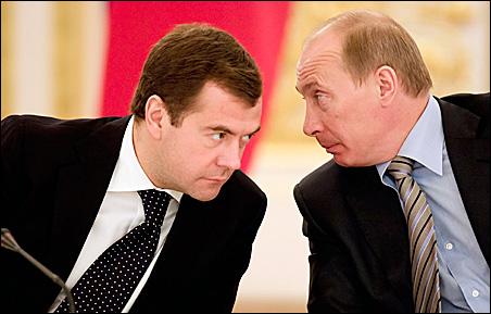 President Dmitry Medvedev, left, and Vladimir Putin confer.
