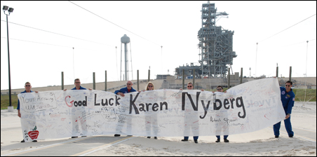 The STS-124 crew members hold up a banner sent to Mission Specialist Karen Nyberg from her high school in Minnesota.