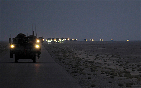 A convoy of Strykers leaves for Kuwait in the early hours of August 16, 2010.