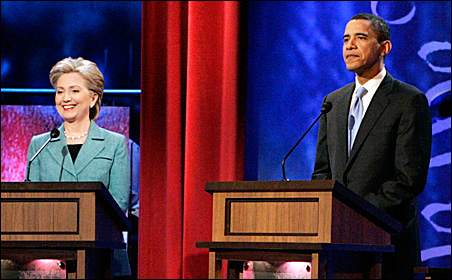 Sens. Hillary Clinton and Barack Obama get ready for their debate in Philadelphia Wednesday.