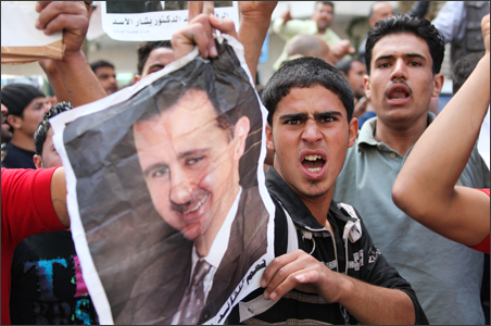 Syrian workers living in Lebanon chant slogans in support of President Bashar al-Assad in front of the Syrian embassy in Beirut.