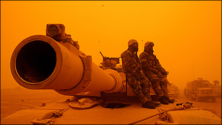 """U.S. soldiers sit on top of their tanks near the southern Iraqi city of Karbala in 2003. A new report by a military insider says the war in Iraq """"has achieved the status of a major war and a major debacle."""""""