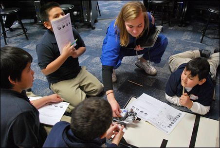 """Instructor Joule helps students program a """"Mars rover."""""""