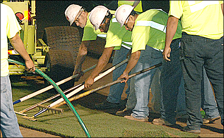 Crews carefully align the sod at Target Field for a snug fit.