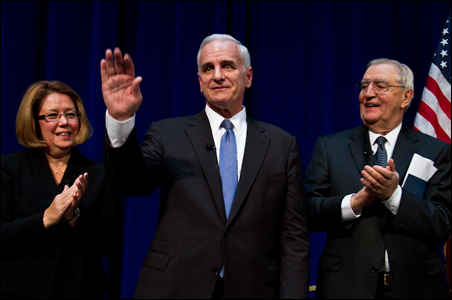 Gov. Mark Dayton, flanked by Lt. Gov. Yvonne Prettner Solon and Walter Mondale, acknowledges well-wishers.