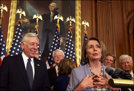 House Majority Leader Steny Hoyer and Speaker of the House Nancy Pelosi celebrate healthcare bill passage after vote on Capitol Hill on Sunday.