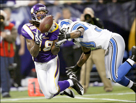 Minnesota Vikings receiver Sidney Rice catches a 56-yard pass over Detroit Lions safety Ko Simpson during the fourth quarter.