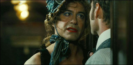 "Robert Downey Jr. (in the dress) and Jude Law in ""Sherlock Holmes: A Game of Shadows"""