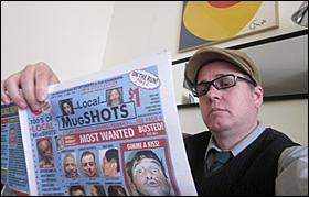 """Max leafing through """"Local MugSHOTS"""""""